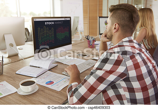 Man analyzing some data on computer - csp46409303