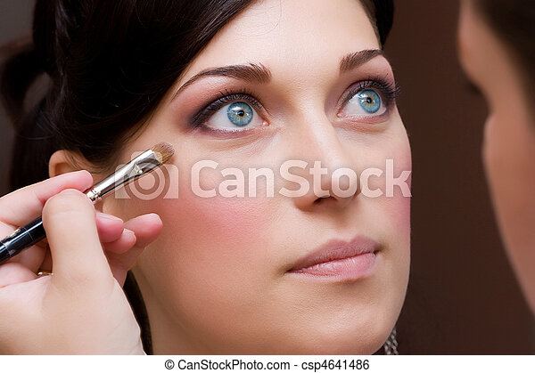 make up artist makeing a colour correction with an brush - csp4641486