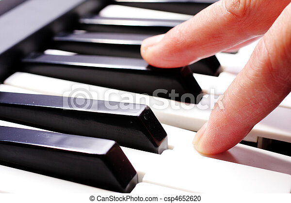hands playing music on the piano, hands and piano player, keyboard . - csp4652620