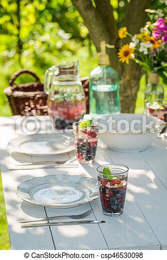 Preparations for homemade dinner in summer garden