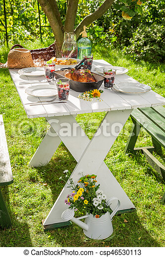 Hot dinner with potatoes and chicken served in the garden