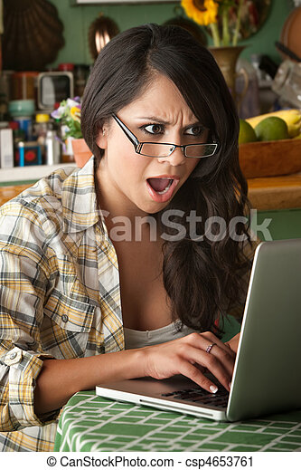 Shocked Beautiful Latina Woman with Computer - csp4653761