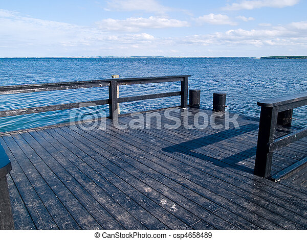 Small wooden jetty dock deck - csp4658489