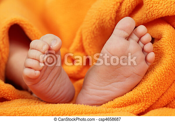 Tiny feet of a newborn baby - csp4658687