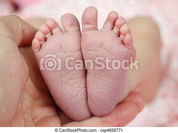Tiny feet of a newborn baby - csp4658771