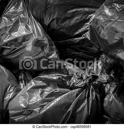 Textured of black plastic garbage bag for background