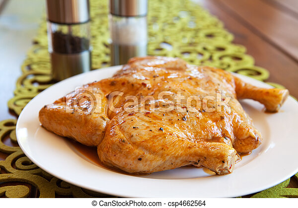 Uncooked whole chicken on a white plate - csp4662564