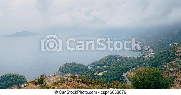 Budva Riviera in Montenegro at night. Sea coast and the mountains