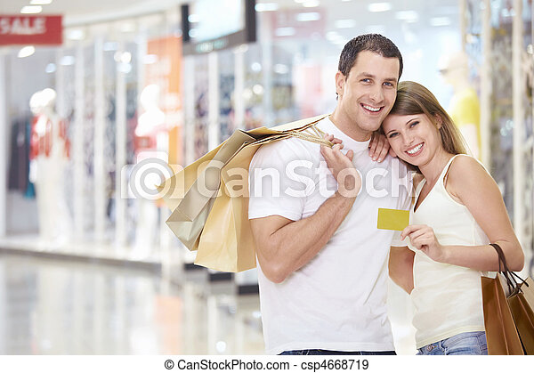 Couple in store with a credit card - csp4668719