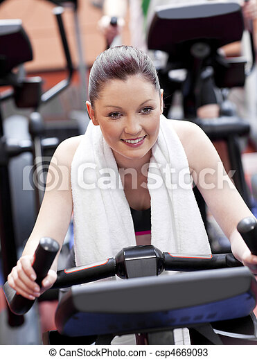 Portrait of a positive woman doing exercises in a sport centre - csp4669093