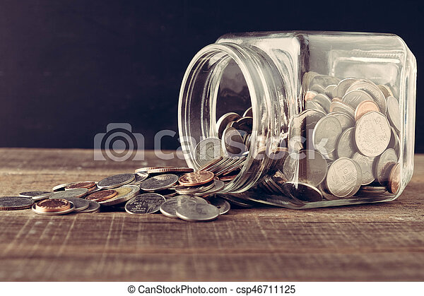 business finance. save money for investment concept money in the glass with filter effect retro vintage style