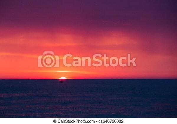Natural Purple Color Sunset Or Sunrise Sky Over Sea After Storm Rain. Seascape With Shining Setting Sun On Sea Horizon.