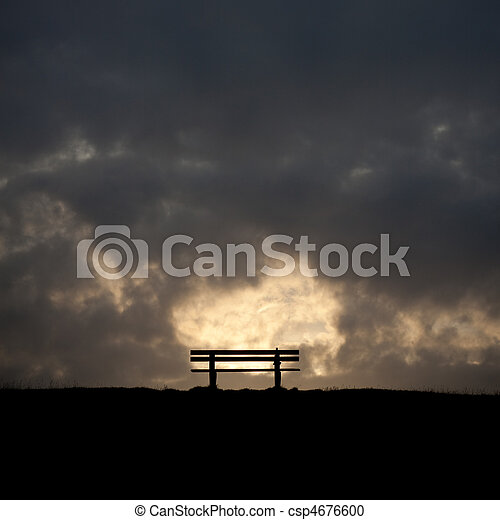 bench in the sunset on a dike at the northsea - csp4676600