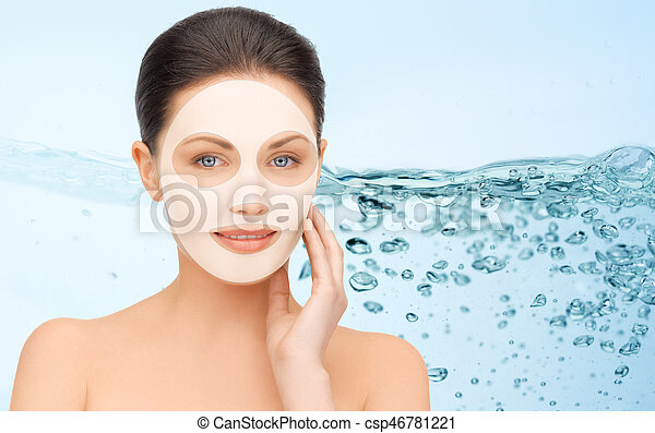 beautiful young woman with collagen facial mask - csp46781221
