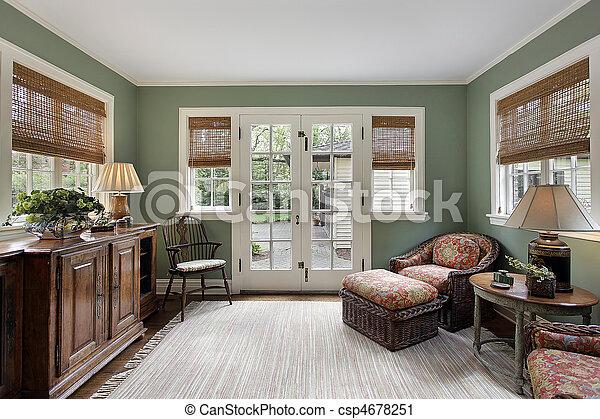 Den with doors to patio - csp4678251