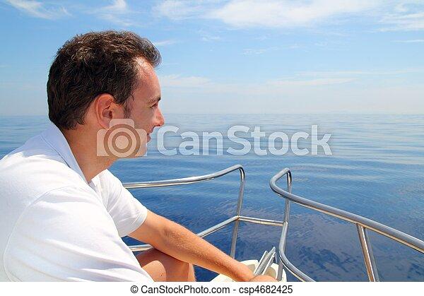 Sailor man sailing boat blue calm ocean water - csp4682425