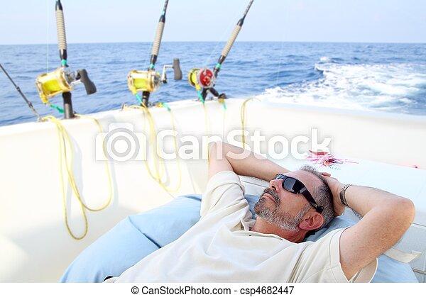 Sailor senior fisherman relax on boat fishing sea - csp4682447