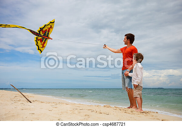 Dad and son flying kite - csp4687721