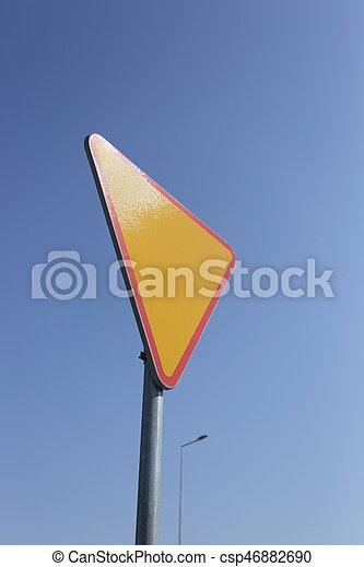 Give way yellow traffic sign. - csp46882690