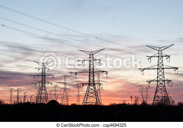 Electrical Transmission Towers (Electricity Pylons) at Sunset - csp4694325