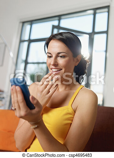amazed woman holding cellphone - csp4695483