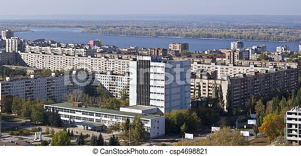 Urban landscape. Typical residential area on the riverbank. The view from the heights in the background the river Volga and Zhiguli Mountains. Russia. - csp4698821