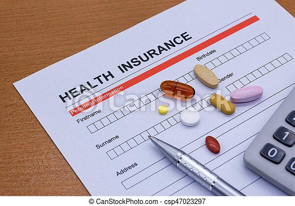 Health insurance paperwork, medicine, stethoscope. Health insurance claim concept.