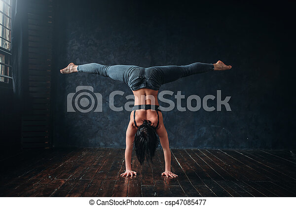 Contemp dancing exercise in dance class. Energy sport woman pose in studio