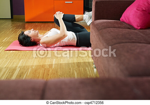 woman doing abs exercise at home - csp4712356