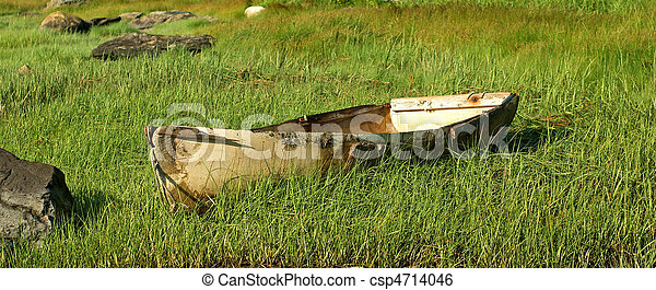 Image of Old worn out fiberglass boat - An old discarded fiberglass ...