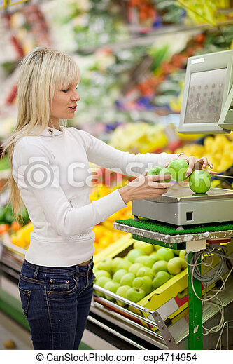 Beautiful young woman shopping for fruits and vegetables in produce department of a grocery store/supermarket - csp4714954