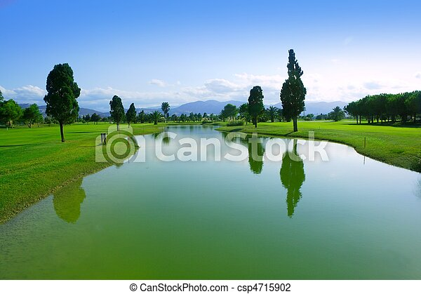 Golf course green grass field lake reflection - csp4715902