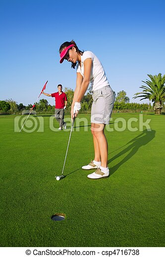 golf woman player green putting hole golf ball - csp4716738