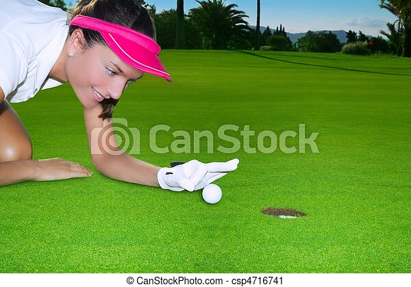 Golf green hole woman humor flicking hand a ball - csp4716741