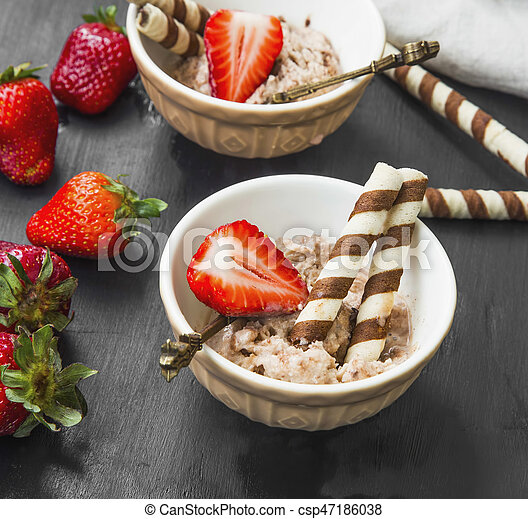 Chocolate sorbet with strawberry fruits desserts in cups, summer refreshing ice desserts