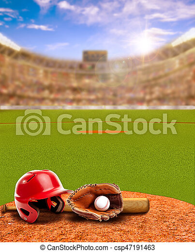 Sunset on baseball stadium full of fans in the stands with baseball helmet, bat, glove and ball on infield dirt clay. Deliberate focus on foreground with shallow depth of field on background and sun flare for effect. Copy space.