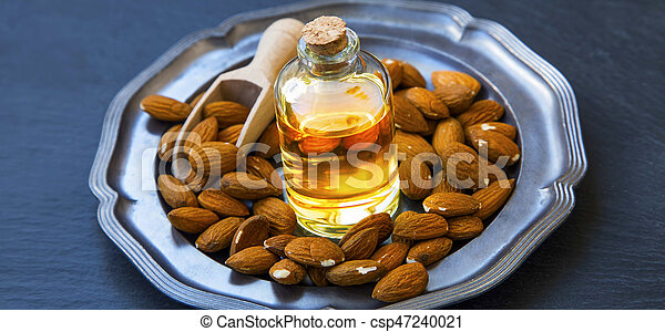 Sweet almonds oil for skincare and food use , healthy fats oil , alternative medicine