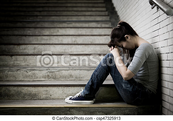 depressed woman feel upset and sit in underground