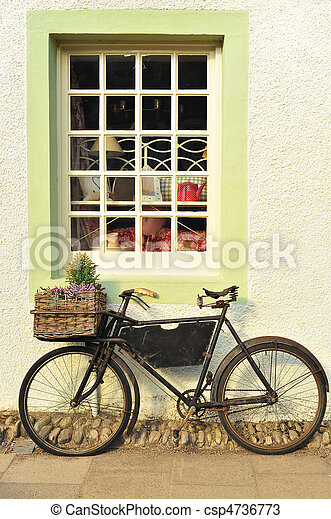 Bike Outside an Old-Fashioned Shop - csp4736773