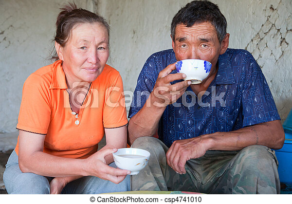 A man and a woman of Asian appearance have tea  - csp4741010