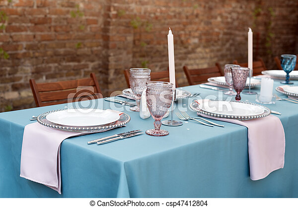 Table decorations for holidays and wedding dinner. Table set for holiday, event, party or wedding reception in outdoor restaurant