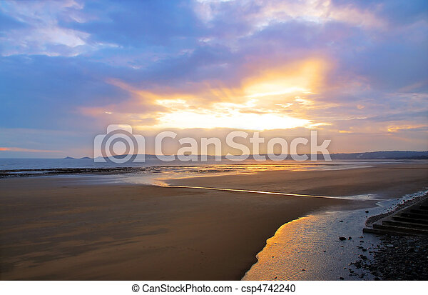 A beautiful sunset over Swansea beach, Wales - csp4742240