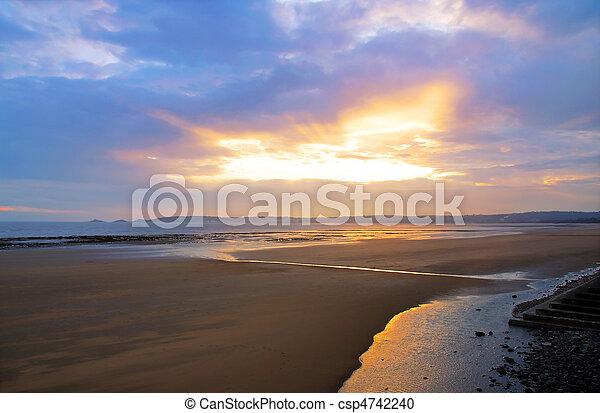 A beautiful sunset over Swansea beach, Wales - csp4742240