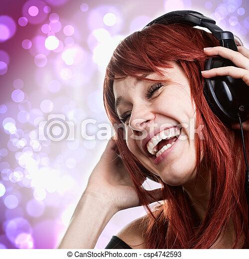 Happy woman having fun with music headphones - csp4742593