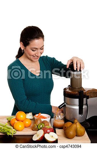 Woman making fruit juice - csp4743094