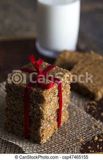 Stack of oatmeal crunchy cookies and milk in background - csp47465155