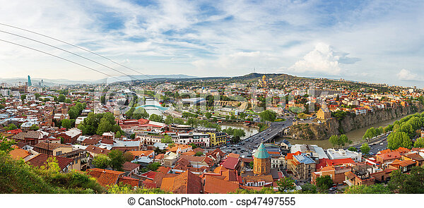 Large panorama view of Tbilisi, capital of Georgia country. View from Narikala fortress. Cable road above tiled roofs.