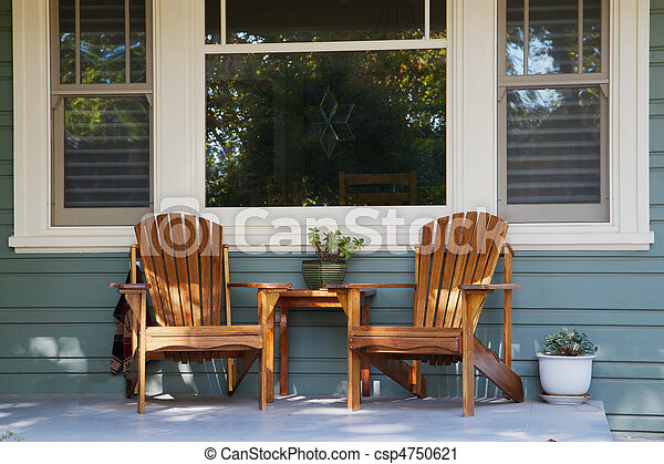 Two adirondack chairs porch - csp4750621