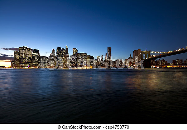 The New York City skyline at w Brooklyn Bridge - csp4753770