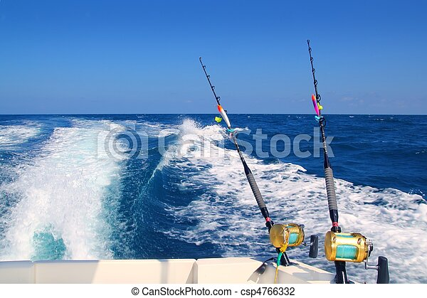 Trolling fishing boat rod and golden saltwater reels - csp4766332